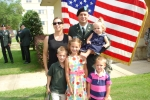 Lt Adam Stenberg, wife Sharalyn and Everett, Georgia, Eleanor and Bennett at OCS graduation.